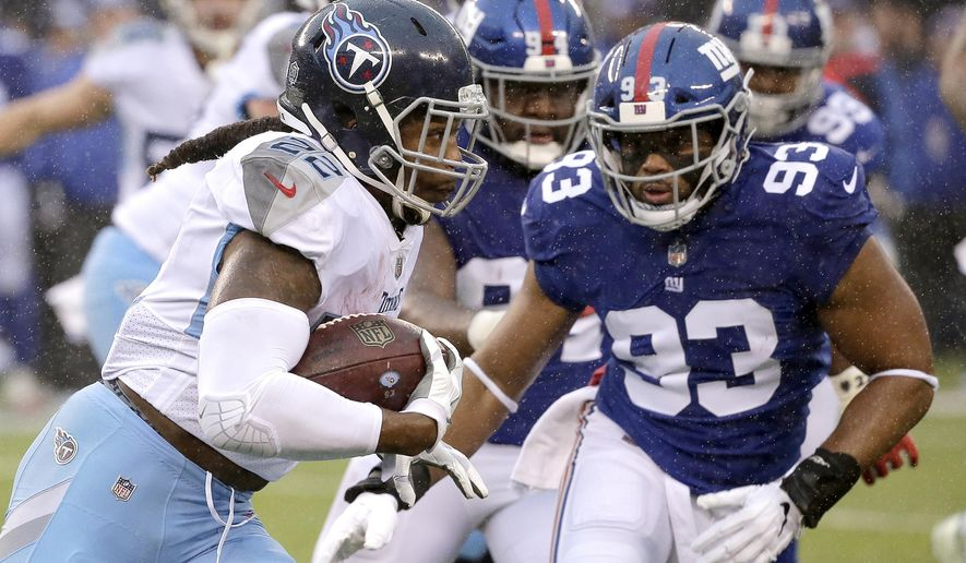 Tennessee Titans running back Derrick Henry, left, runs with the ball as New York Giants middle linebacker B.J. Goodson (93) moves in for the tackle during the first half of an NFL football game, Sunday, Dec. 16, 2018, in East Rutherford, N.J. (AP Photo/Seth Wenig)
