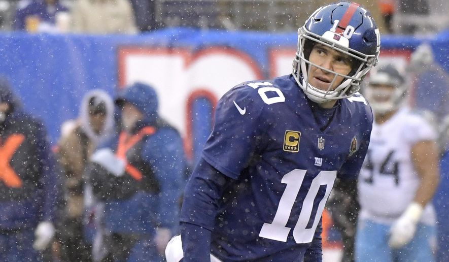 New York Giants quarterback Eli Manning reacts after losing a fumble to the Tennessee Titans during the second half of an NFL football game, Sunday, Dec. 16, 2018, in East Rutherford, N.J. (AP Photo/Bill Kostroun)