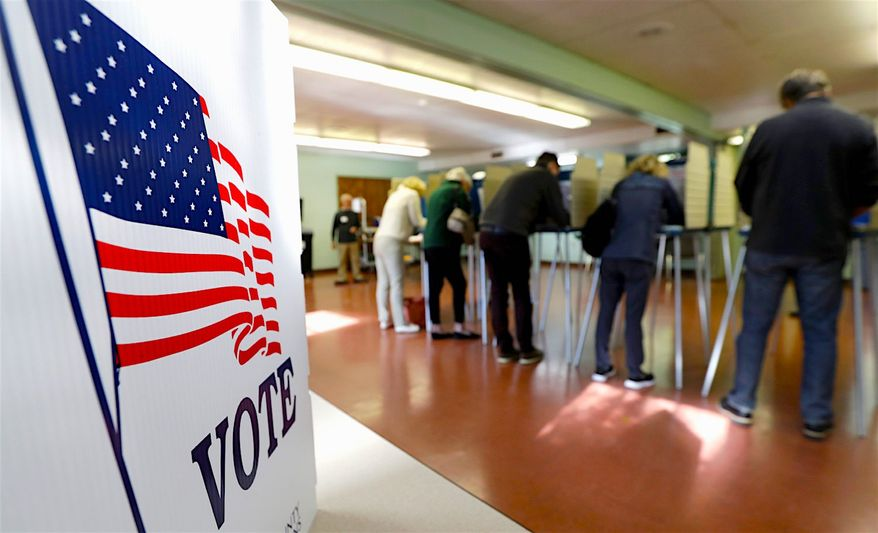 People vote on Nov. 6 in Gates Mills, Ohio. A poll finds that Americans who cast their ballot in the midterm election enjoyed the experience. (Associated Press)