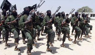 In this Thursday, Feb. 17, 2011, file photo, hundreds of newly trained al-Shabab fighters perform military exercises in the Lafofe area some 18 km south of Mogadishu, in Somalia. Somali intelligence officials say the largest U.S. military airstrike against al-Shabab extremists in Somalia in nearly a year largely destroyed a training camp on Friday, Oct. 12, 2018, and killed more fighters than the U.S. announced. (AP Photo/Farah Abdi Warsameh, File)