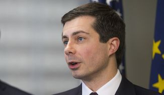 South Bend Mayor Pete Buttigieg announces that he will not seek another term as mayor Monday, Dec. 17, 2018, during a news conference at his office in South Bend, Ind. (Robert Franklin/South Bend Tribune via AP)