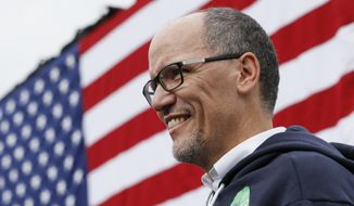 In this Nov. 4, 2018, file photo, Tom Perez, chairman of the Democratic National Committee, waits to speak during an early voting campaign event in Cincinnati. (AP Photo/John Minchillo, File)
