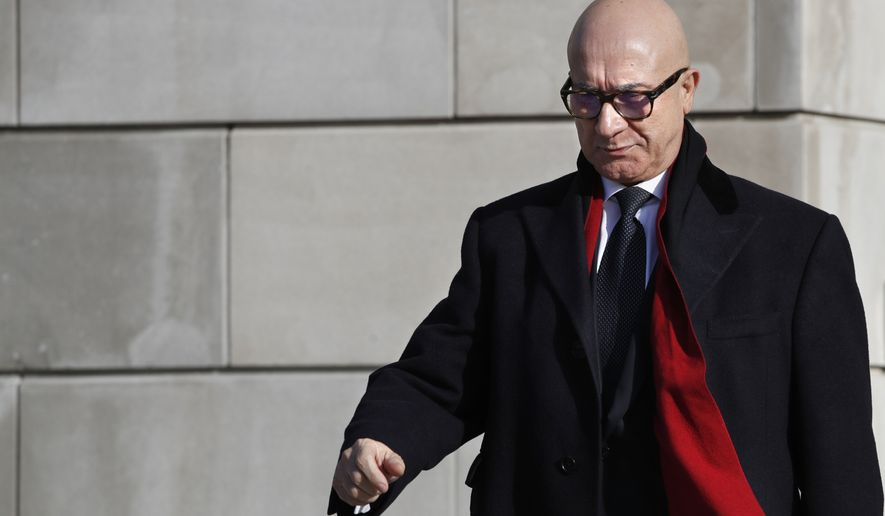 Bijan Kian, whose full name is Bijan Rafiekian, leaves the FBI Washington Field Office in Washington, Monday, Dec. 17, 2018. Rafiekian, a one-time business partner of former National Security Adviser Michael Flynn, has been indicted on charges including failing to register as a foreign agent. According to the indictment, Rafiekian was vice-chairman of Flynn's business group, the Flynn Intel Group. The two worked to have cleric Fethullah Gulen extradited. (AP Photo/Jacquelyn Martin)