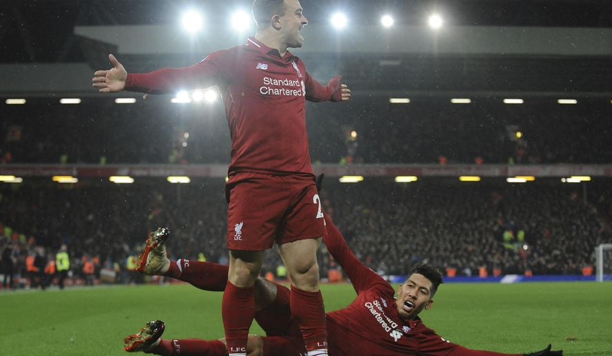 Liverpool's Xherdan Shaqiri celebrates after scoring his side's second goal during the English Premier League soccer match between Liverpool and Manchester United at Anfield in Liverpool, England, Sunday, Dec. 16, 2018. (AP Photo/Rui Vieira)