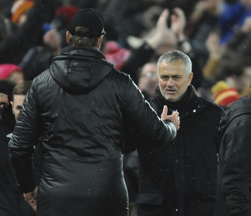 Liverpool manager Juergen Klopp, left, and Manchester United manager Jose Mourinho shake hands after the English Premier League soccer match between Liverpool and Manchester United at Anfield in Liverpool, England, Sunday, Dec. 16, 2018. (AP Photo/Rui Vieira)