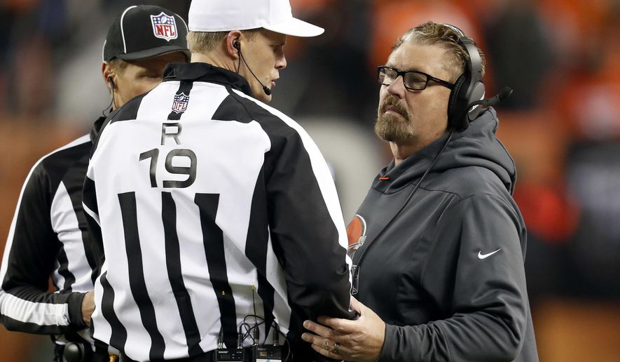 Cleveland Browns head coach Gregg Williams speaks with umpire Clay Martin (19) during the second half of an NFL football game against the Denver Broncos, Saturday, Dec. 15, 2018, in Denver. (AP Photo/David Zalubowski)