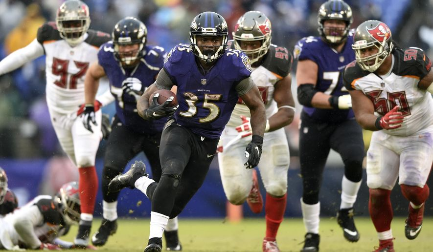 Baltimore Ravens running back Gus Edwards (35) rushes the ball in the second half of an NFL football game against the Tampa Bay Buccaneers, Sunday, Dec. 16, 2018, in Baltimore. (AP Photo/Gail Burton)