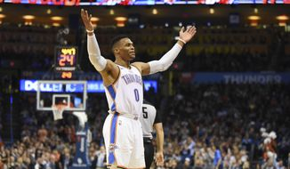 Oklahoma City Thunder guard Russell Westbrook hypes up the crowd in the first half of an NBA basketball game against the Chicago Bulls in Oklahoma City, Monday, Dec. 17, 2018. (AP Photo/Kyle Phillips)