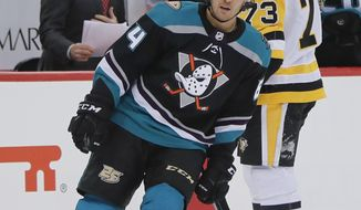 Anaheim Ducks' Kiefer Sherwood (64) skates past Pittsburgh Penguins' Jack Johnson (73) as he heads to the bench after Sherwood scored during the second period of an NHL hockey game, Monday, Dec. 17, 2018, in Pittsburgh. (AP Photo/Keith Srakocic)