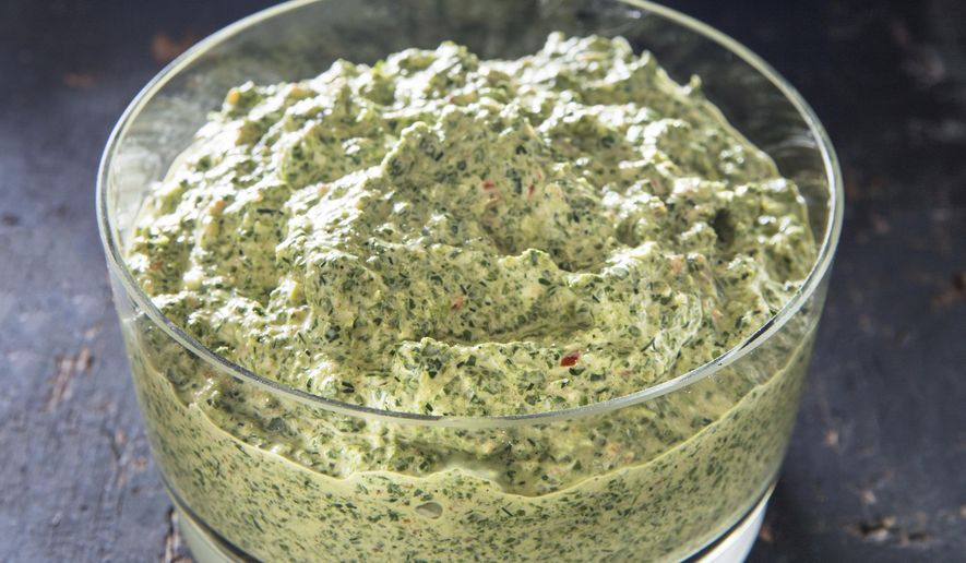 "This undated photo provided by America's Test Kitchen in October 2018 shows Herbed Spinach Dip in Brookline, Mass. This recipe appears in the cookbook ""All-Time Best Appetizers."" (Joe Keller/America's Test Kitchen via AP)"