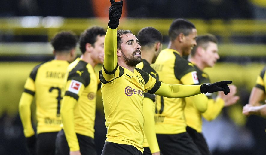 FILE - In this Dec. 15, 2018 file photo Dortmund's Paco Alcacer celebrates after scoring the opening goal during the German Bundesliga soccer match between Borussia Dortmund and Werder Bremen in Dortmund, Germany. Borussia Dortmund fans are dreaming of a first Bundesliga title since 2012 and former coach Juergen Klopp has joined in his praise of the side after its stellar start to the season. (AP Photo/Martin Meissner, file)