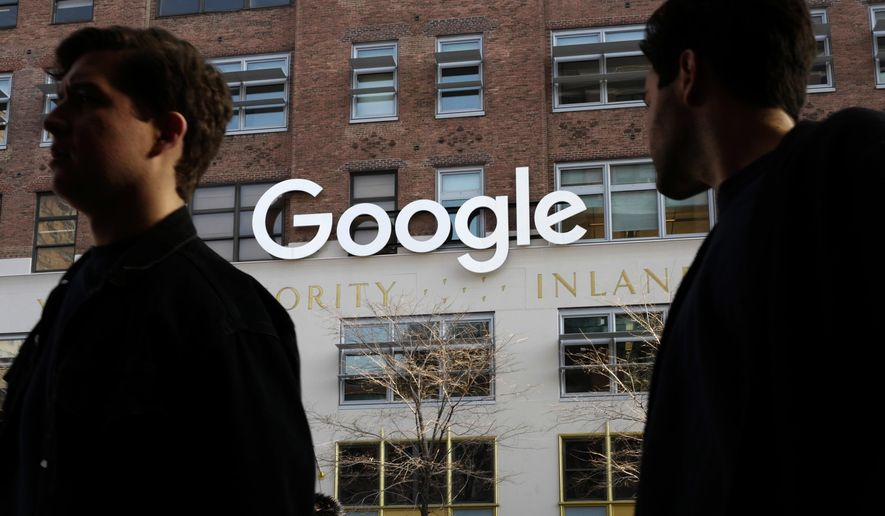 In this Dec. 4, 2017, file photo, people walk by Google offices in New York. Google is spending more than $1 billion to expand operations in New York City. Ruth Porat, senior vice president and chief financial officer at Google and Alphabet, said in a blog post Monday, Dec. 17, 2018, that Google is creating a more than 1.7 million square-foot campus that includes lease agreements along the Hudson River in lower Manhattan. (AP Photo/Mark Lennihan, File)
