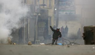 Kashmiri protesters clash with Indian paramilitary soldiers in Srinagar, Indian controlled Kashmir, Sunday, Dec. 16, 2018. A security clampdown and a strike sponsored by separatists fighting against Indian rule shut most of Indian-administered Kashmir on Sunday, a day after chaotic protests and fighting killed seven civilians and four combatants in the disputed region. (AP Photo/Mukhtar Khan)