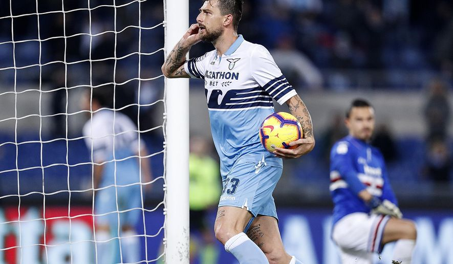 Lazio's Francesco Acerbi celebrates after scoring his side's opening goal during the Serie A soccer match between Lazio and Sampdoria at the Olympic stadium in Rome, Saturday, Dec. 8, 2018. (Riccardo Antimiani/ANSA via AP)