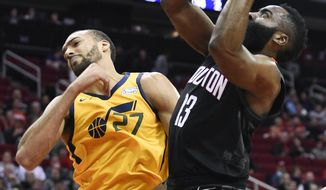 Houston Rockets guard James Harden, right, drives to the basket as Utah Jazz center Rudy Gobert defends during the first half of an NBA basketball game, Monday, Dec. 17, 2018, in Houston. (AP Photo/Eric Christian Smith)