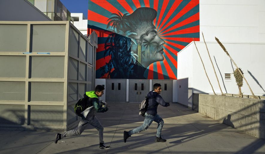 A mural by artist Beau Stanton of actress Ava Gardner is seen at the Robert F. Kennedy Community Schools complex school in Los Angeles Thursday, Dec. 13, 2018. Protesters say the mural suggests the Japanese imperial battle flag, a symbol that offends Korean groups. The artist, Beau Stanton, denies any connection. The L.A. School District has agreed to paint over the mural during the winter break, said Roberto Martinez, the senior school district administrator for that region, according to a report by the Los Angeles Times. (AP Photo/Damian Dovarganes)