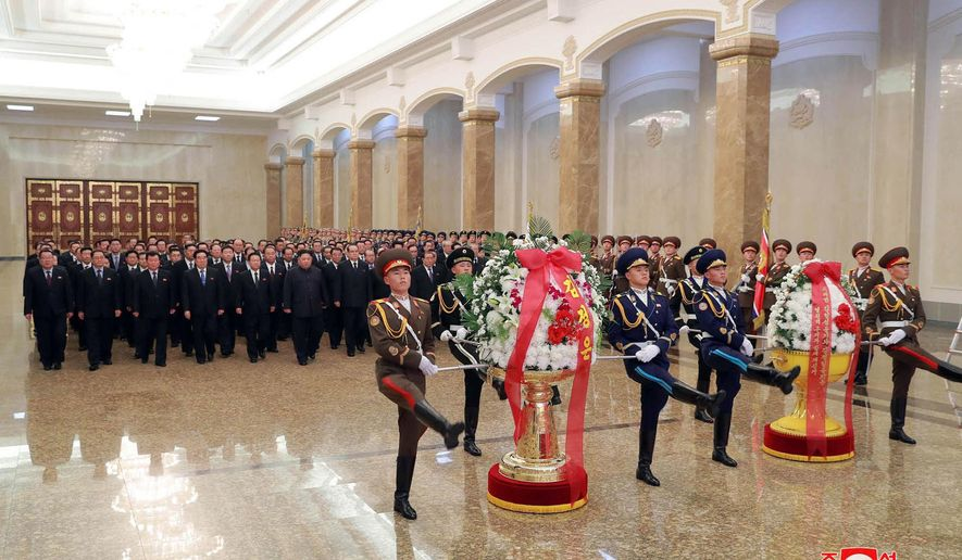 """In this photo provided by the North Korean government, North Korean leader Kim Jong Un, sixth from left, visits the Kumsusan Palace of the Sun, where the body of late leader Kim Jong Il is laid, in Pyongyang, North Korea, Monday, Dec. 17, 2018.  North Koreans are marking the seventh anniversary of the death of leader Kim Jong Il with visits to statues and vows of loyalty to his son and successor, Kim Jong Un. Independent journalists were not given access to cover the event depicted in this image distributed by the North Korean government. The content of this image is as provided and cannot be independently verified. Korean language watermark on image as provided by source reads: """"KCNA"""" which is the abbreviation for Korean Central News Agency. (Korean Central News Agency/Korea News Service via AP)"""