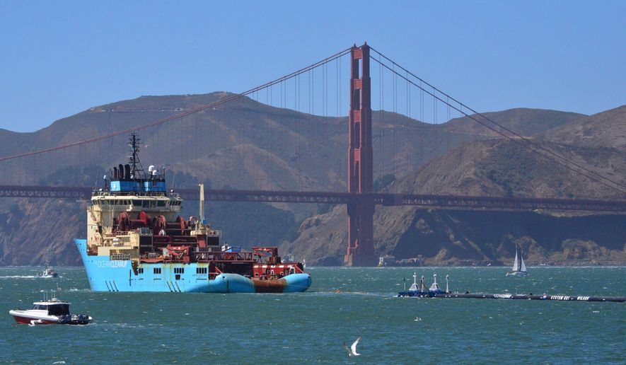 File - In this Sept. 8, 2018 file photo, a ship tows The Ocean Cleanup's first buoyant trash-collecting device toward the Golden Gate Bridge in San Francisco en route to the Pacific Ocean. The trash collection device deployed to corral plastic litter floating between California and Hawaii in an attempt to clean up the world's largest garbage patch is not collecting any trash. But Boyan Slat, who launched the Pacific Ocean cleanup project, told The Associated Press in an interview Monday, Dec. 17, 2018, he is confident the 2,000-foot (600-meter) long floating boom will be fixed.  (AP Photo/Lorin Eleni Gill, File)