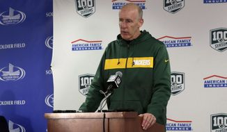 FILE - In this Sunday, Dec. 16 2018, file photo, Green Bay Packers head coach Joe Philbin talks during a news conference after a 24-17 loss to the Chicago Bears in an NFL football game in Chicago. Their slim playoff hopes are gone. The Packers are assured of a losing record. Interim coach Joe Philbin must keep his players motivated while determining whether to rest key veterans or injured players at the end of a lost season. (AP Photo/David Banks, File)