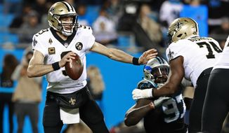 New Orleans Saints' Drew Brees (9) scrambles against the Carolina Panthers in the first half of an NFL football game in Charlotte, N.C., Monday, Dec. 17, 2018. (AP Photo/Jason E. Miczek)