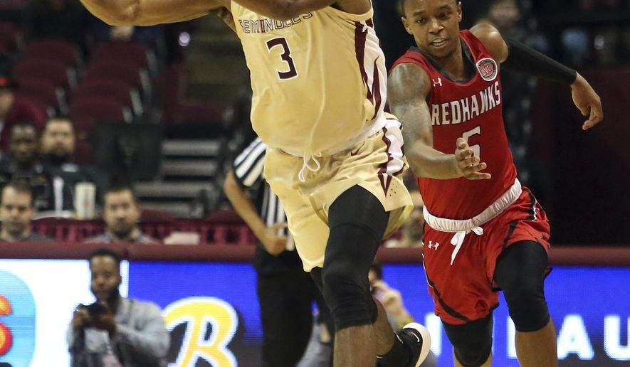 Florida State's Trent Forrest (3) passes the ball upcourt while pursued by Southeast Missouri's Jonathan Dalton in the second half of an NCAA college basketball game Monday, Dec. 17, 2018, in Tallahassee, Fla. (AP Photo/Steve Cannon)