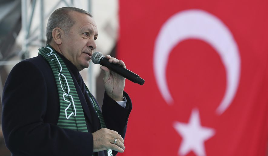 "Turkey's President Recep Tayyip Erdogan delivers a speech during a rally in Konya, Turkey, Monday, Dec. 17, 2018. Erdogan said he received ""positive answers"" from U.S. President Donald Trump on the situation in northern Syria, where Turkey has threatened to launch a new operation against American-backed Syrian Kurdish fighters. The two leaders spoke by phone Friday. (Presidential Press Service via AP, Pool)"