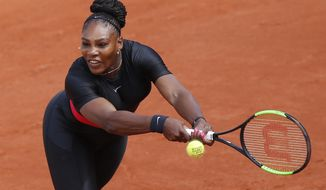 FILE - In this May 29, 2018, file photo, Serena Williams returns a shot against Krystyna Pliskova during their first-round match of the French Open tennis tournament in Paris, France. The women's tennis tour has approved rule changes that involve seedings after a return from pregnancy. Former No. 1 players Williams and Victoria Azarenka are recent mothers on the tour. (AP Photo/Michel Euler, File)