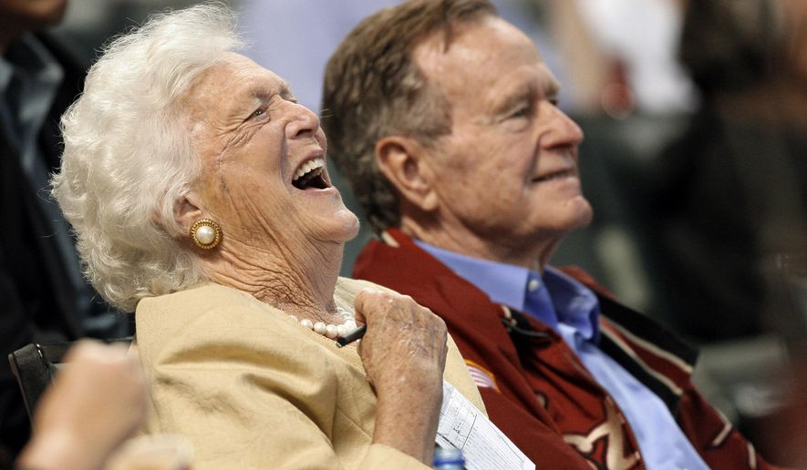 FILE - In this April 18, 2009, file photo, Barbara Bush laughs alongside former President George H.W. Bush, right, as they attend a baseball game in Houston. Barbara Bush, the snowy-haired first lady whose plainspoken manner and utter lack of pretense made her more popular at times than her husband, President George H.W. Bush, died Tuesday, April 17, 2018. She was 92. (AP Photo/David J. Phillip, File)