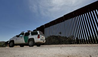A Customs and Border Patrol agent patrols the international border Tuesday, April 10, 2018 in Nogales, Ariz. The Republican governors of Texas, Arizona and New Mexico on Monday committed 1,600 Guard members to the border, giving President Donald Trump many of the troops he requested to fight what he's called a crisis of migrant crossings and crime. (AP Photo/Matt York)