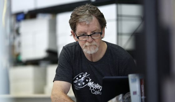 In this Monday, June 4, 2018, photograph, baker Jack Phillips, owner of Masterpiece Cakeshop, manages his shop after the U.S. Supreme Court ruled that he could refuse to make a wedding cake for a same-sex couple because of his religious beliefs did not violate Colorado's anti-discrimination law in Lakewood, Colo. (AP Photo/David Zalubowski) **FILE**