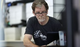 In this Monday, June 4, 2018, file photograph, baker Jack Phillips, owner of Masterpiece Cakeshop, manages his shop after the U.S. Supreme Court ruled that he could refuse to make a wedding cake for a same-sex couple because of his religious beliefs did not violate Colorado's anti-discrimination law in Lakewood, Colo. Attorneys for Philliups are in federal court in Denver Tuesday, Dec. 18, 2018, to seek to overturn a Colorado Civil Rights Commission ruling that the baker discriminated against a transgender person by refusing to make a cake to mark the person's transition from male to female. (AP Photo/David Zalubowski, File)