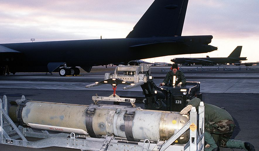 MARK 60 CAPTOR - Airmen from the 42nd Munitions Maintenance Squadron prepare to load a Mark 60 CAPTOR (encapsulated torpedo) anti-submarine mine onto a 42nd Bombardment Wing B-52G Stratofortress aircraft during Ghost Warrior, a joint Air Force/Navy exercise conducted during the base's conventional operational readiness inspection.