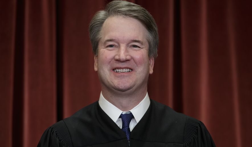 In this Nov. 30, 2018, file photo Associate Justice Brett Kavanaugh sits with fellow Supreme Court justices for a group portrait at the Supreme Court Building in Washington. A panel of judges has dismissed ethics complaints against Kavanaugh. The judges say the complaints must be dismissed because they were filed under a federal law that does not apply to Supreme Court justices. (AP Photo/J. Scott Applewhite, File)