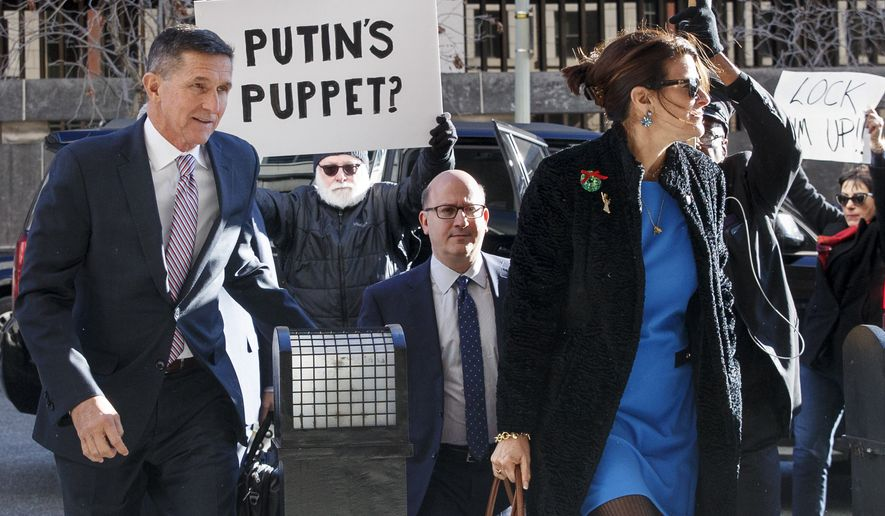 President Donald Trump's former National Security Adviser Michael Flynn, his attorney Robert Kelner and Mr. Flynn's wife Lori Andrade arrive at federal court in Washington, Tuesday, Dec. 18, 2018. (AP Photo/Carolyn Kaster)
