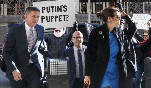 President Donald Trump's former National Security Advisor Michael Flynn, his attorney Robert Kelner and his wife Lori Andrade arrive at federal court in Washington, Tuesday, Dec. 18, 2018. (AP Photo/Carolyn Kaster)