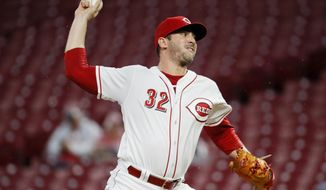 FILE - In this Tuesday, Sept. 25, 2018 file photo, Cincinnati Reds starting pitcher Matt Harvey throws during the first inning of the team's baseball game against the Kansas City Royals in Cincinnati. A person familiar with the negotiations tells The Associated Press that pitcher Matt Harvey has agreed to an $11 million, one-year contract with the Los Angeles Angels. The person spoke Tuesday, Dec. 18, 2018 on condition of anonymity because the agreement had not yet been announced.(AP Photo/John Minchillo, File)