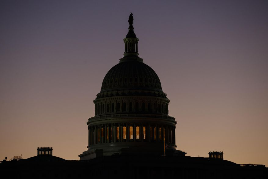The U.S. Capitol Building Dome is seen before the sun rises in Washington, Tuesday, Dec. 18, 2018. (AP Photo/Carolyn Kaster)