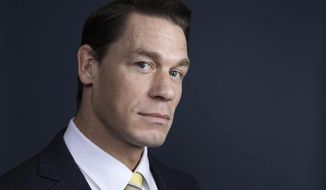 """This Dec. 9, 2018 photo shows WWE star-turned-actor John Cena posing for a portrait at the Four Seasons Hotel to promote his  film """"Bumblebee"""" in Los Angeles. (Photo by Rebecca Cabage/Invision/AP)"""