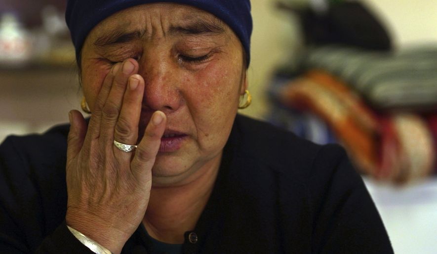In this Dec. 6, 2018 photo, Nurbakyt Kaliaskar cries as she speaks about her daughter's detainment in a Chinese internment camp during an interview in Almaty, Kazakhstan. Kaliaskar, who lives in neighboring Kazakhstan, says her 25-year-old daughter is a college graduate who had a white-collar job. Then she got swept up in a Chinese crackdown on Muslims in Xinjiang. (AP Photo/ Dake Kang)
