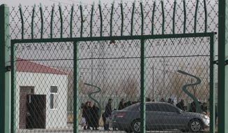 In this Monday, Dec. 3, 2018, photo, residents line up inside the Artux City Vocational Skills Education Training Service Center at the Kunshan Industrial Park in Artux in western China's Xinjiang region. Across the Xinjiang region, a growing number of internment camps have been built, where by some estimates 1 million Muslims are detained, forced to give up their language and their religion and subject to political indoctrination. Now, the Chinese government is also forcing some detainees to work in manufacturing and food industries. Some of them are within the internment camps; others are privately owned, state-subsidized factories where detainees are sent once they are released. (AP Photo/Ng Han Guan)