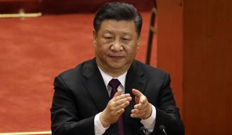 Chinese President Xi Jinping applauds during a conference to commemorate the 40th anniversary of China's Reform and Opening Up policy at the Great Hall of the People in Beijing, Tuesday, Dec. 18, 2018. (AP Photo/Mark Schiefelbein)