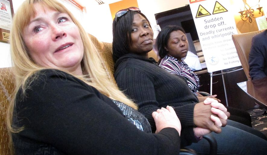 FILE- In this Oct. 25, 2016, file photo, from left, Sandra Smith, left, Tasha Hart and Domonique McNeil speak at a news conference in Egg Harbor Township N.J., about the drowning deaths of relatives at a beach in North Wildwood N.J. On Tuesday, Dec. 18, 2018, a judge dismissed Smith's lawsuit, ruling that New Jersey and North Wildwood are entitled to immunity because the land where the death occurred is unimproved public property. At least three people have died at that inlet in similar accidents. (AP Photo/Wayne Parry, File)