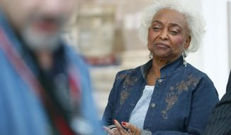 FILE - In this Nov. 16, 2018, file photo, Broward County Supervisor of Elections Brenda Snipes watches as Joe D'Alessandro, Election Planning and Development Director, speaks to members of the media after a hand recount in Lauderhill, Fla. Snipes, a former Florida elections official is asking a federal judge to reinstate her after she was removed from office by Gov. Rick Scott. Snipes filed a lengthy federal lawsuit on Monday, Dec. 17, against Scott and Senate President Bill Galvano. (AP Photo/Wilfredo Lee, File)