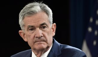 In this Sept. 26, 2018, file photo Federal Reserve Chairman Jerome Powell listens to a question during a news conference in Washington. (AP Photo/Susan Walsh, File)