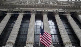 FILE - In this Nov. 20, 2018, file photo an American flag flies outside New York Stock Exchange. Stocks are opening solidly higher on Wall Street as the market claims back some of the ground it lost in steep drops over the previous two days. Technology and industrial stocks were among the biggest winners in early trading Tuesday, Dec. 18. (AP Photo/Mary Altaffer, File)