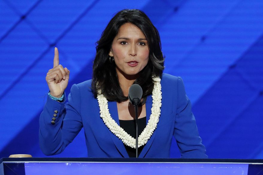 In this July 26, 2016, file photo, Rep. Tulsi Gabbard, D-HI., nominates Sen. Bernie Sanders, I-VT., for president of the United States during the second day of the Democratic National Convention in Philadelphia. (AP Photo/J. Scott Applewhite, File)