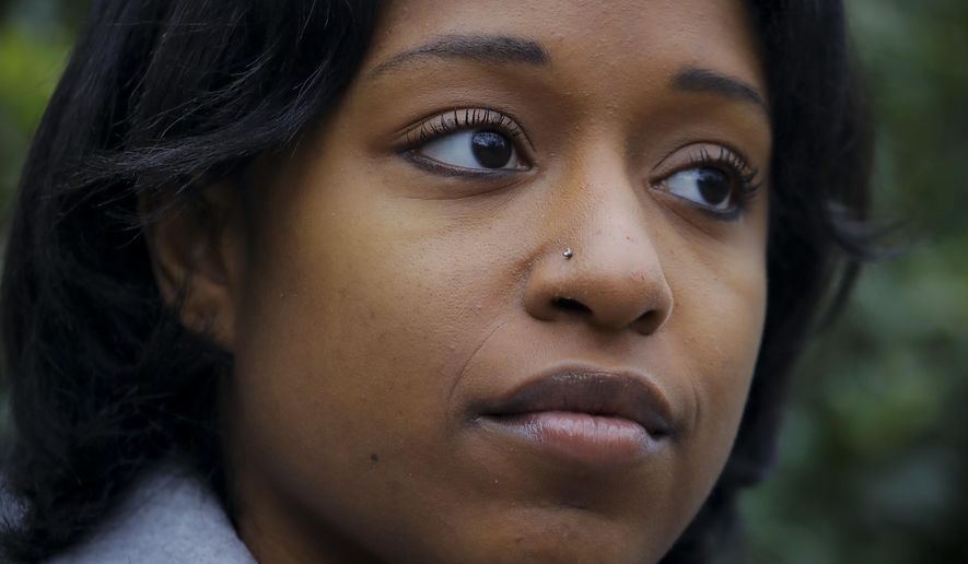 "Taylor Dumpson, who was the first black woman to serve as student government president at American University and who has been the target of racist trolls, poses for a photo on Friday, Dec. 14, 2018. Her location is not included in this caption for her safety. Evan James McCarty, who harassed Dumpson on social media, agreed on Tuesday, Dec. 18, 2018, to a court settlement requiring him to get ""anti-hate training"" and apologize and publicly renounce white supremacy. (AP Photo)"