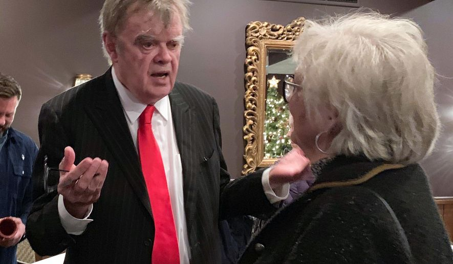 """In this Sunday, Dec. 16, 2018, former """"A Prairie Home Companion"""" host Garrison Keillor talks to fans after his performances at Crooners lounge in Fridley, Minn. Keillor is stepping back into the spotlight a year after Minnesota Public Radio cut ties with him over a sexual misconduct allegation. Keillor performed two sold-out shows Sunday night at Crooners, a jazz nightclub in a Minneapolis suburb near where he grew up. Fans laughed, applauded and sang along. (AP Photo/Jeff Baenen)"""