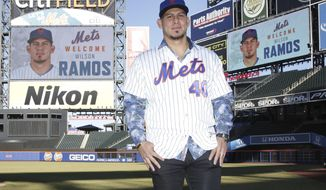 New York Mets catcher Wilson Ramos poses for a picture after an introductory news conference at Citi Field, Tuesday, Dec. 18, 2018, in New York. (AP Photo/Seth Wenig)
