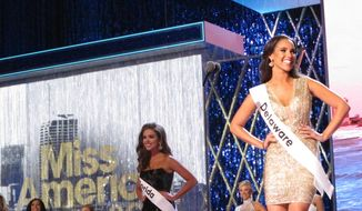 In this Sept. 7, 2018 photo, Miss Delaware Joanna Wicks introduces herself at the start of the third and final night of preliminary competition at the Miss America competition in Atlantic City N.J. As it nears the pageant's 100th anniversary, the Miss America Organization is looking for expressions of interest to host the competition from other cities. (AP Photo/Wayne Parry)